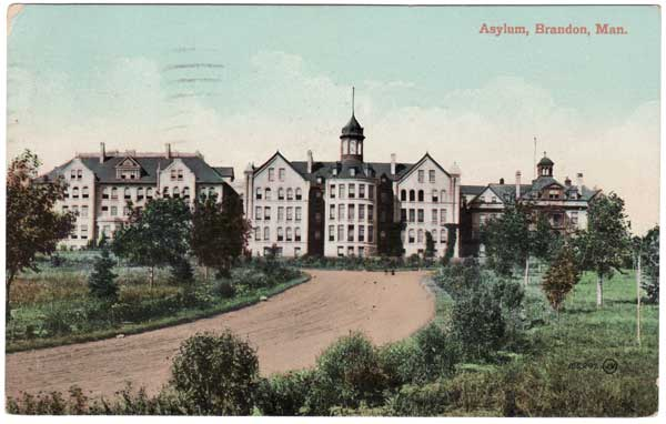 Postcard of the original Brandon Asylum for the Insane, showing the original structure at right, an addition constructed between 1892 and 1893 in the centre, and an addition constructed between 1903 and 1905 at left. The entire complex was destroyed by fire in November 1910