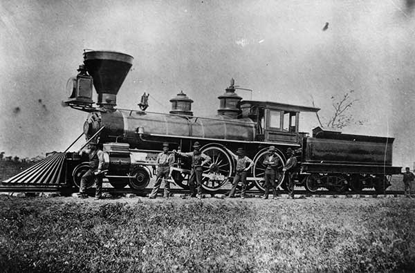"The Crew of Locomotive #2 ""Joseph Whitehead"", strike a pose, circa 1877."