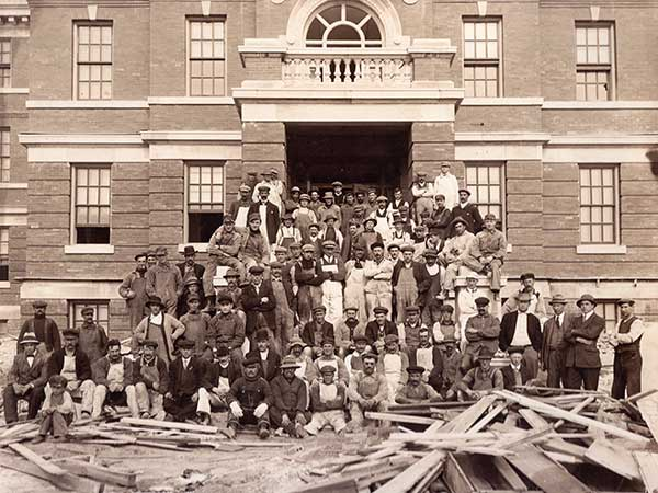 Workers in front of the Parkland Building during renovations