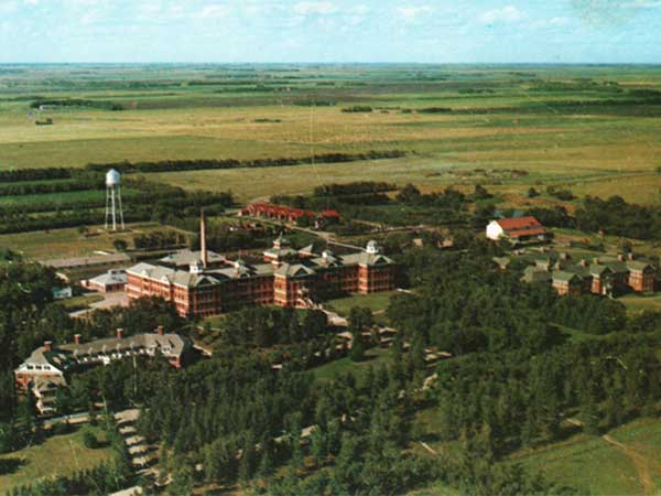 Aerial view of the Brandon Mental Hospital, with the Nurses' Residence at left, Parkland Building in centre, and the Valleyview Building at right