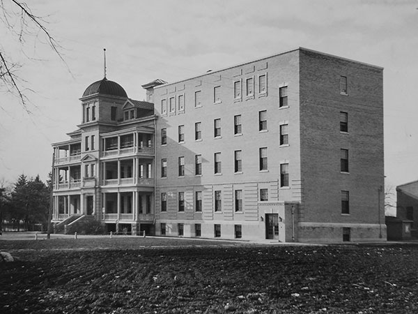 One of the original buildings at left and 1937-1938 addition, designed by architect Gilbert C. Parfitt, at right at Manitoba School for Mental Defectives